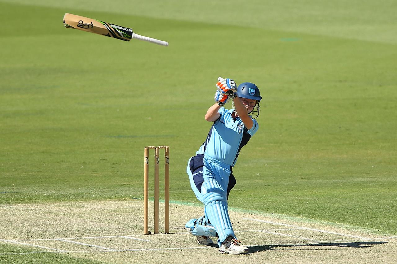 PERTH, AUSTRALIA - JANUARY 19: Rachael Haynes of the Breakers loses her grip on the bat during the women's Twenty20 final match between the NSW Breakers and the Western Australia Fury at WACA on January 19, 2013 in Perth, Australia.  (Photo by Paul Kane/Getty Images)