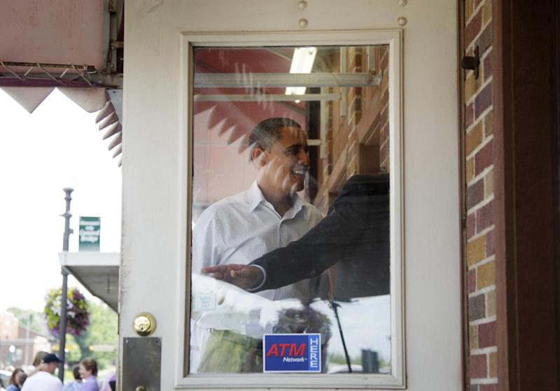 President Barack Obama enters The Coffee Mill Restaurant, Monday, Aug. 15, 2011, in Zumbrota, Minn., during his three-day economic bus tour.  (AP Photo/Carolyn Kaster)