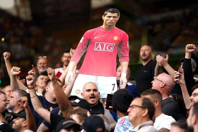 Manchester United fans celebrated Cristiano Ronaldo's impending return to the club during Sunday's 1-0 Premier League win at Wolvesmier League – Molineux Stadium