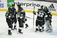 Los Angeles Kings players celebrate a 4-2 win over Colorado Avalanche in an NHL hockey game Thursday, Jan. 21, 2021, in Los Angeles. (AP Photo/Ashley Landis)