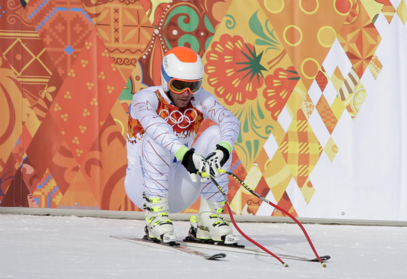 United States' Bode Miller sits on his skis after finishing the men's downhill at the Sochi 2014 Winter Olympics, Sunday, Feb. 9, 2014, in Krasnaya Polyana, Russia. (AP Photo/Gero Breloer)