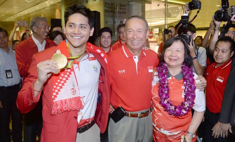 File image of Singapore's Joseph Schooling posing with his Rio Olympics gold medal after reaching home. AFP