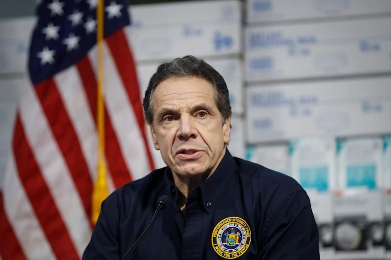 New York Gov. Andrew Cuomo speaks during a news conference against a backdrop of medical supplies at the Jacob Javits Center that will house a temporary hospital in response to the COVID-19 outbreak on March 24 in New York.
