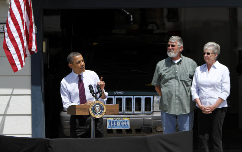 President Barack Obama, accompanied by Val and Paul Keller, speaks about home mortgages outside the Kellers home in Reno, Nev., Friday,  May 11, 2012.  Obama met with the Kellers who recently refinanced their home loan under a federally backed program that the President wants to expand to all homeowners who are paying their mortgages on time.(AP Photo/Rich Pedroncelli)