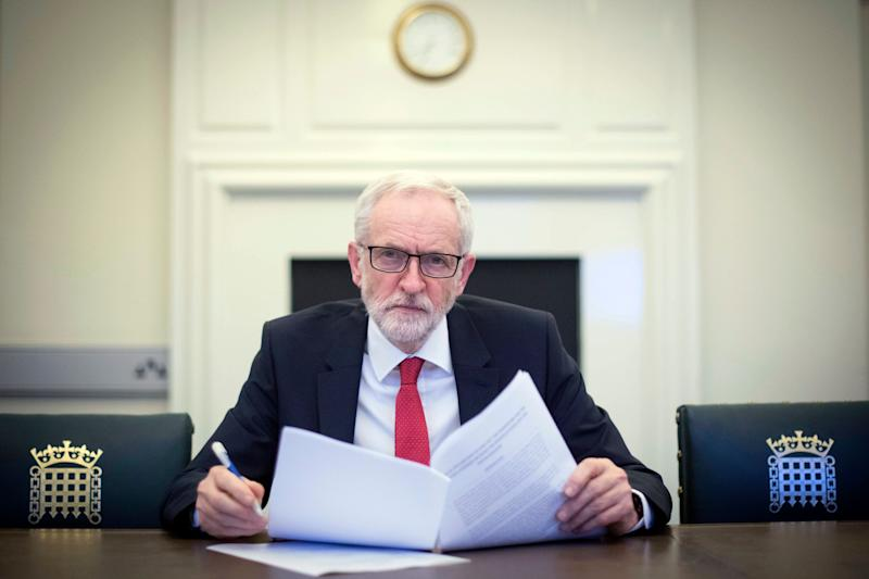 "Britain's Labour leader Jeremy Corbyn poses for the media with the Political Declaration setting out the framework for the future UK-EU relationship, in his office in the Houses of Parliament in London, Tuesday, April 2, 2019. Opposition leader Corbyn says he is happy to sit down with Prime Minister Theresa May to work on a Brexit deal, even though ""so far she hasn't shown much sign of compromise."" The leader of the left-of-center Labour Party says ""we recognize that she has made a move"" and is willing to hold talks with May. (Stefan Rousseau/Pool Photo via AP)"