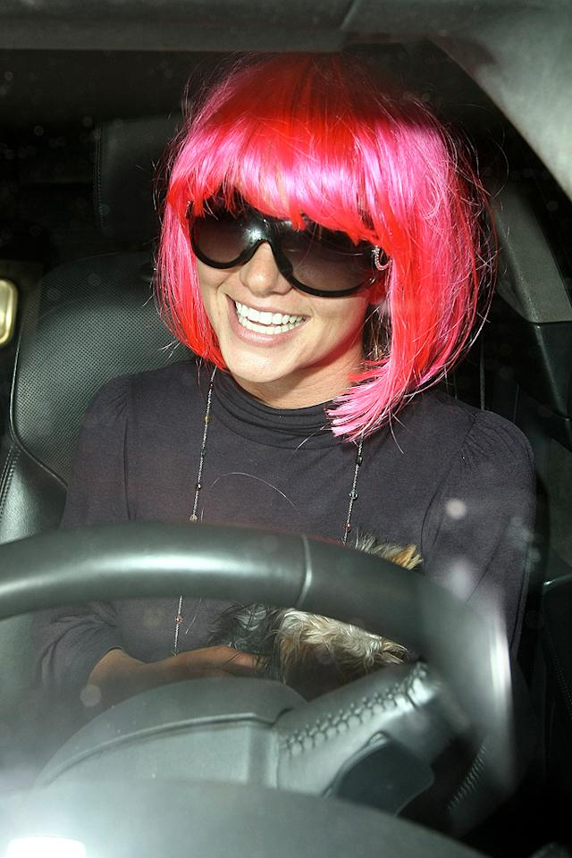 "<p class=""MsoNoSpacing"">As Britney's locks grew back, she debuted a number of different looks thanks to extensions and her favorite hairpiece: a pink wig. The pop star donned the wig all over, whether it was for dinner at the Four Seasons or late-night joy rides around L.A. ""When she puts on the pink wig, you just know something crazy is about to happen,"" one paparazzo told <em style="""">People</em> in January 2008. For example, while wearing the mop top, Britney was often overheard talking in a British accent. But when Brit's conservatorship kicked in, her father Jamie confiscated it, as evidenced by a photo in February 2008 of Mr. Spears carrying the wig out to his car. Where it is now is anyone's guess.</p>"