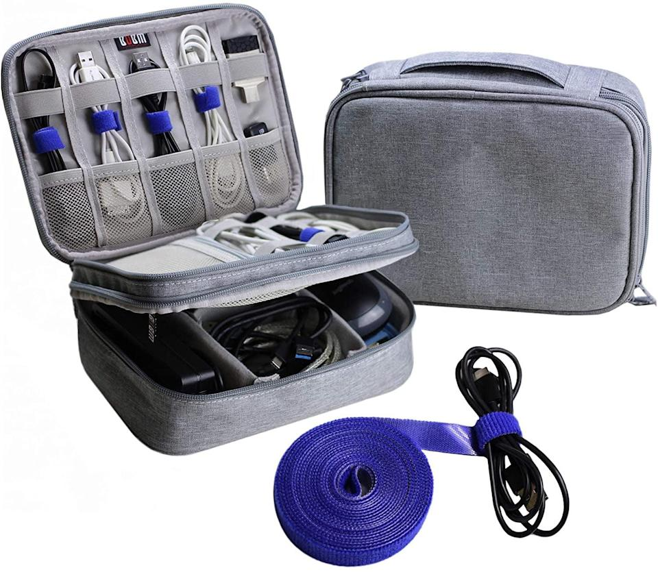 <p>An unorganized traveler who's always on the go could get some use out of this handy <span>Electronics Organizer Travel Cable Cord Bag</span> ($18). All the little sections are so handy.</p>