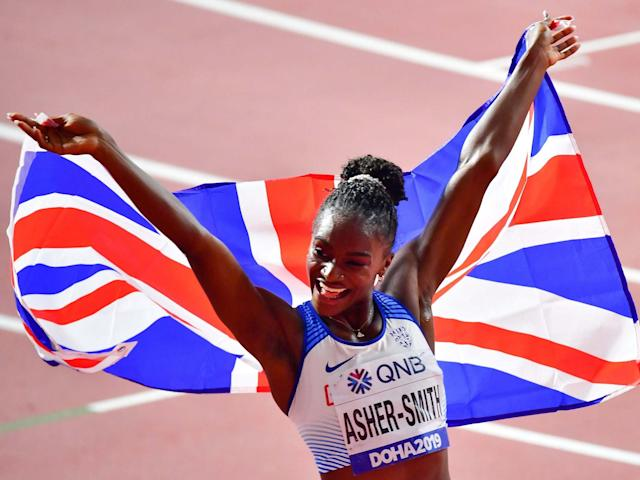 Dina Asher-Smith celebrates clinching her first world title: Getty