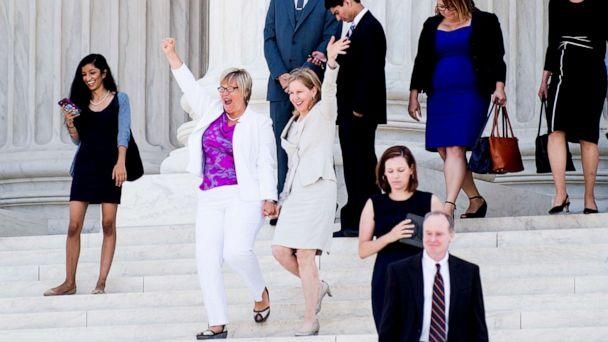 PHOTO: Texas abortion provider Amy Hagstrom-Miller and Nancy Northup, President of The Center for Reproductive Rights wave to supporters as they decend the steps of the United States Supreme Court on June 27, 2016, in Washington. (Pete Marovich/Getty Images)