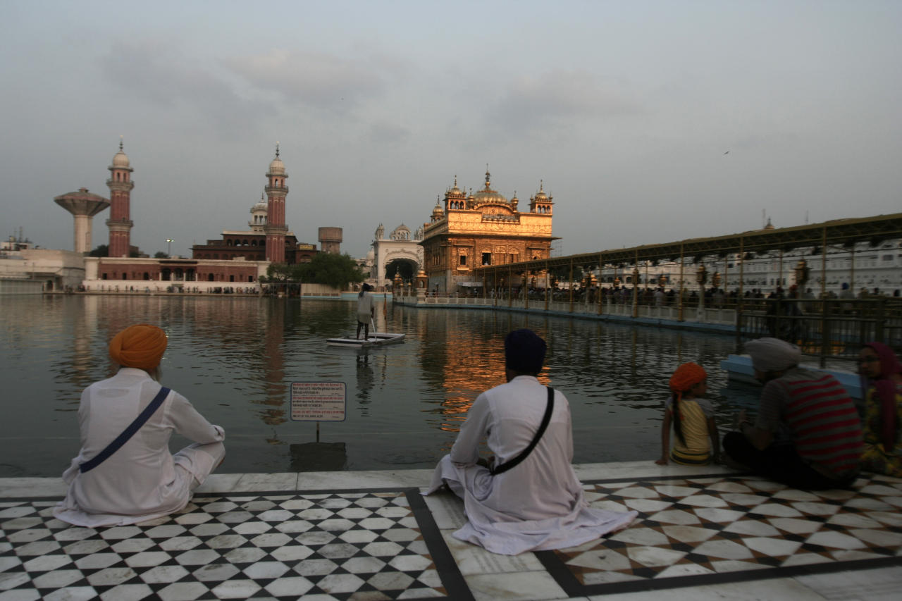 Indian Sikh devotees offer prayers at the Golden Temple, Sikh's holiest shrine in Amritsar, India, Monday, Aug. 6, 2012. Indian Prime Minister Manmohan Singh said Monday that he was shocked and saddened by the shooting attack that killed six people at a Sikh house of worship in the U.S. state of Wisconsin. (AP Photo/Sanjeev Syal)