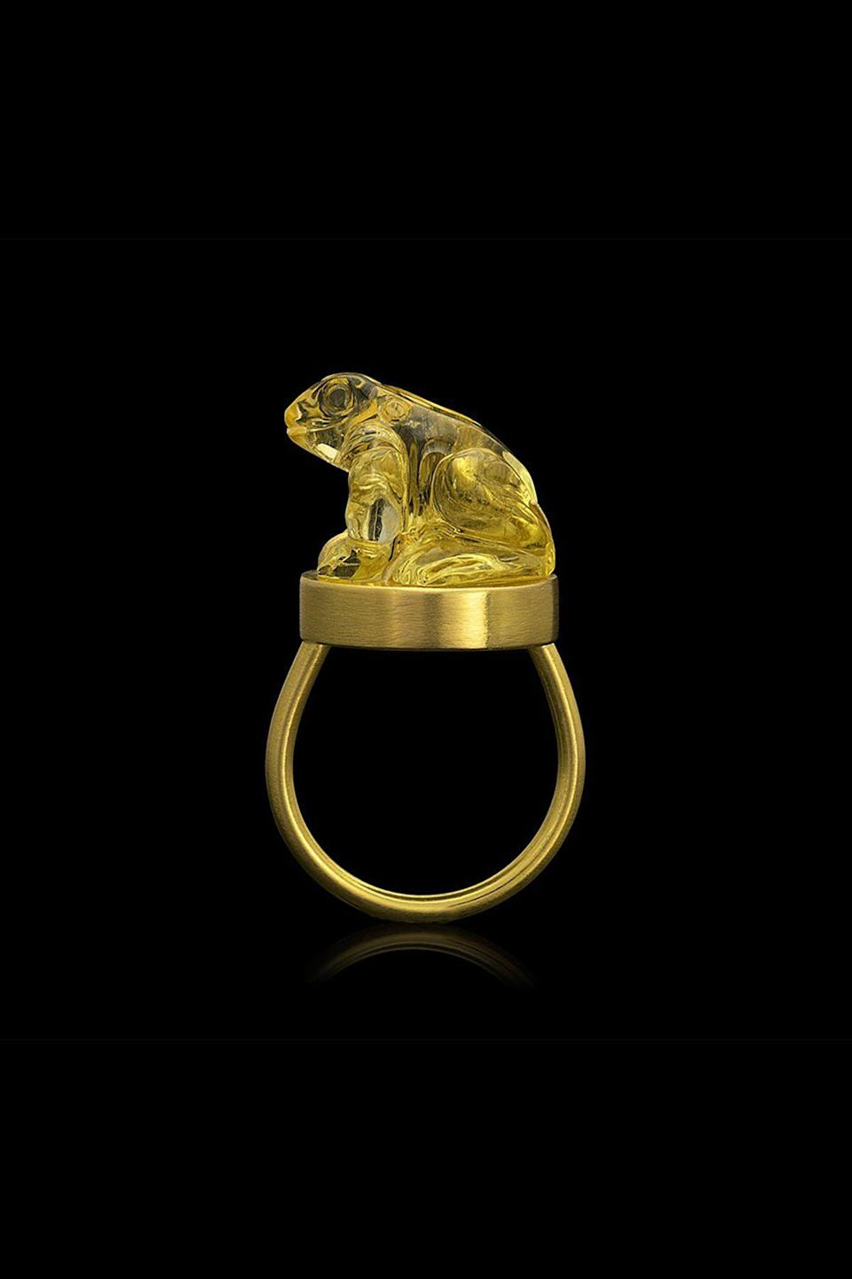 """<p><strong>Loren Nicole</strong></p><p>loren-nicole.com</p><p><strong>$9000.00</strong></p><p><a href=""""https://www.loren-nicole.com/collections/rings/products/amulet-ring-heket-beryl"""" rel=""""nofollow noopener"""" target=""""_blank"""" data-ylk=""""slk:Shop Now"""" class=""""link rapid-noclick-resp"""">Shop Now</a></p><p>Loren Nicole Teetelli might have the most unconventional background of all the designers on this list: she used to be archaeologist. Since transitioning to the world of jewelry in 2016, she has channeled her passion for ancient techniques and civilizations into crafting unique talismans. Take this 22k gold ring, for example, which is crowned with a yellow Beryl that has been hand-carved by a master lapidary into the shape of Heket, the Egyptian goddess of fertility. </p>"""