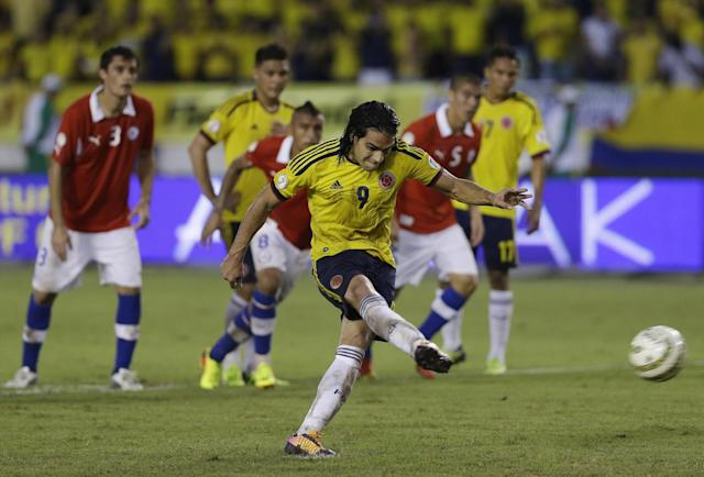 Colombia's Radamel Falcao Garcia scores his side's third goal from the penalty spot during a 2014 World Cup qualifying soccer match against Chile in Barranquilla, Colombia, Friday, Oct. 11, 2013. Colombia tied 3-3 and and booked its ticket for the 2014 finals in Brazil. (AP Photo/Ricardo Mazalan)