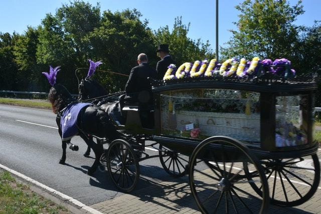 The horsedrawn carriage carrying the coffin of 16-year-old Louise Smith (Ben Mitchell/PA)