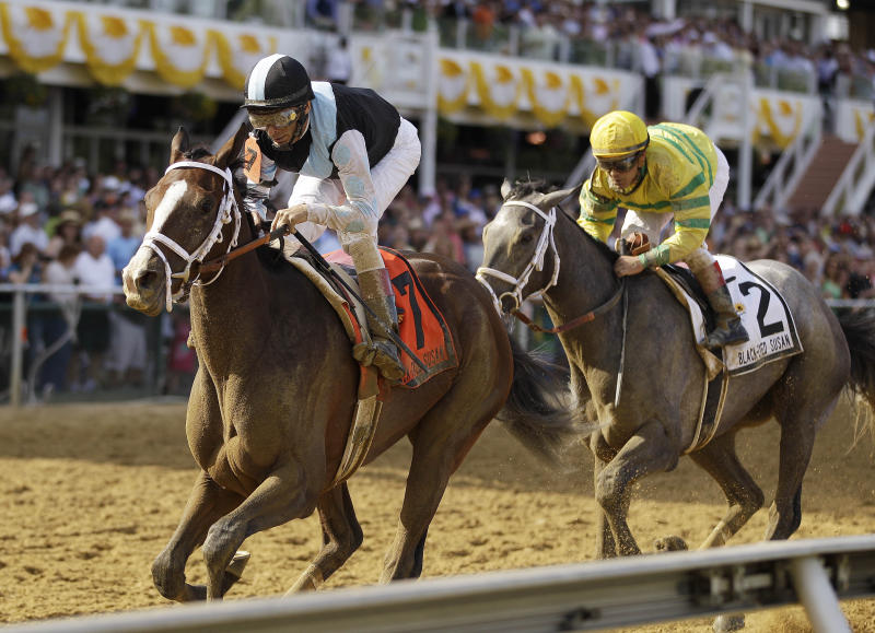 In Lingerie (7), ridden by John Velazquez, crosses the finish line ahead of Disposablepleaseure, ridden by Javier Castellano, to win the Black-Eyed Susan Stakes horse race at Pimlico Race Course, Friday, May 18, 2012, in Baltimore. (AP Photo/Matt Slocum)