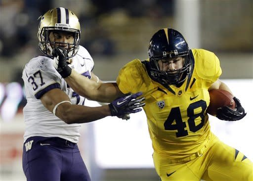 California fullback Eric Stevens (48) fends off Washington linebacker Princeton Fuimaono (37) during the first half of an NCAA college football game in Berkeley, Calif., Friday, Nov. 2, 2012. (AP Photo/Marcio Jose Sanchez)