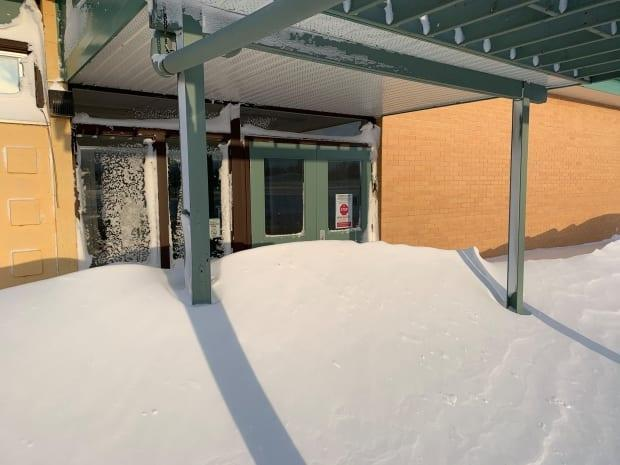 Some snow drifts were six-feet high and blocked doors or windows at Stewart Valley School.