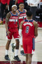 Washington Wizards guard Bradley Beal, left, reacts at the end of the team's NBA basketball game against the Portland Trail Blazers in Portland, Ore., Saturday, Feb. 20, 2021. (AP Photo/Craig Mitchelldyer)
