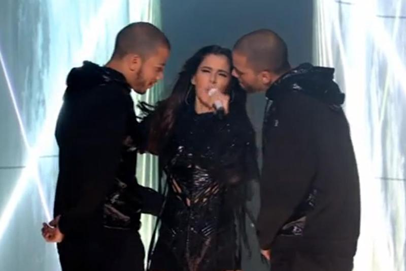 Raunchy: Cheryl on The X Factor with male backing dancers (ITV)
