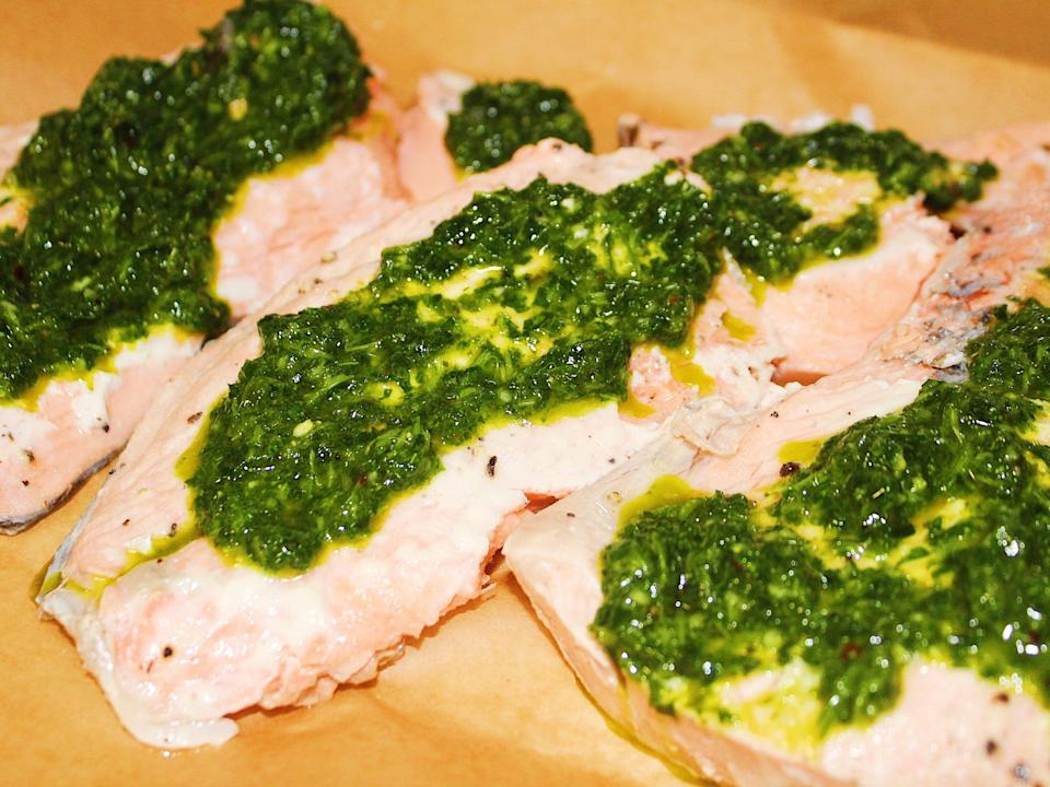 finished salmon fillets with salsa verde