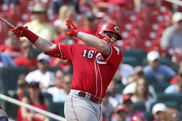 Cincinnati Reds' Tucker Barnhart follows through on a three-run double during the eighth inning in the first baseball game of a doubleheader against the St. Louis Cardinals, Saturday, Aug. 31, 2019, in St. Louis. (AP Photo/Jeff Roberson)