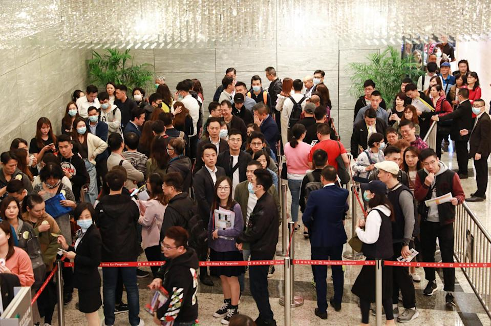 Buyers queuing for Sun Hung Kai Properties' offer of 335 units of its Wetland Seasons Park residential project at the developer's sales office at the International Commerce Centre (ICC) in West Kowloon on January 11, 2020. Photo: May Tse