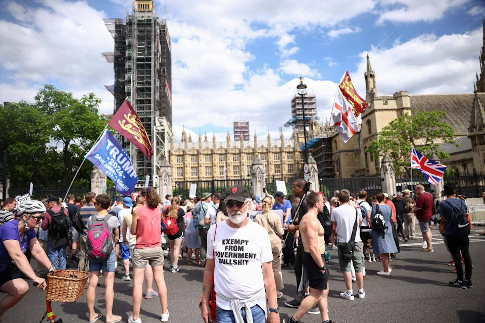 Anti-lockdown and anti-vaccine demonstrators gather at the gates of the Houses of Parliament during a protest, amid the coronavirus disease (COVID-19) pandemic, London, Britain, June 14, 2021. REUTERS/Henry Nicholls