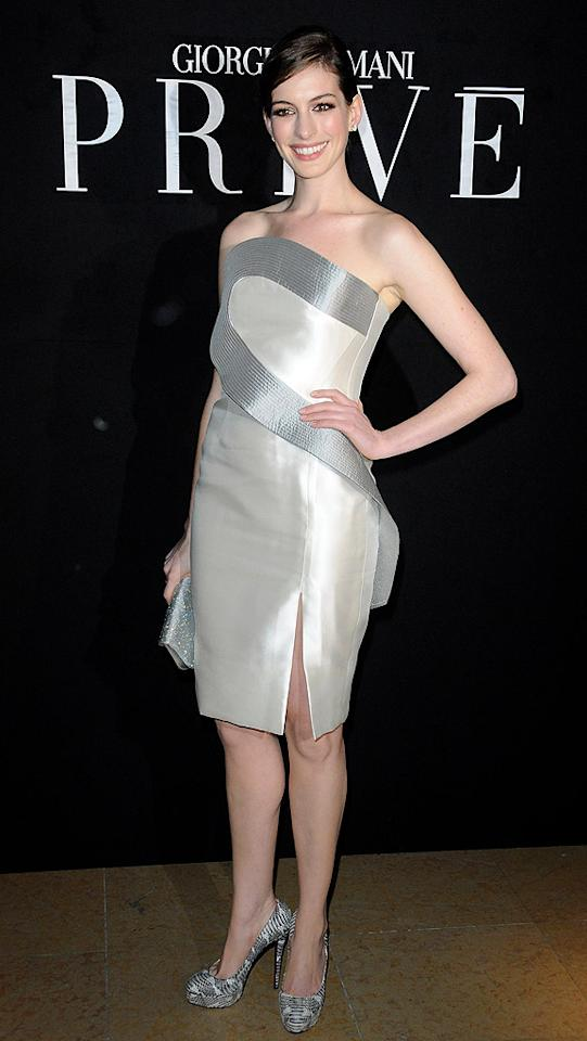 """Anne Hathaway -- who's scheduled to announce the Oscar noms at the crack of dawn on February 2 -- sparkled upon arriving at the Giorgio Armani Prive Fashion Show at Paris Fashion Week in an exquisite white-and-silver sheath courtesy of the couturier. Pascal Le Segretain/<a href=""""http://www.gettyimages.com/"""" target=""""new"""">GettyImages.com</a> - January 25, 2010"""
