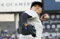 New York Yankees' Anthony Rizzo throws the ball to fans during the first inning of a baseball game against the Baltimore Orioles, Monday, Aug. 2, 2021, in New York. (AP Photo/Mary Altaffer)