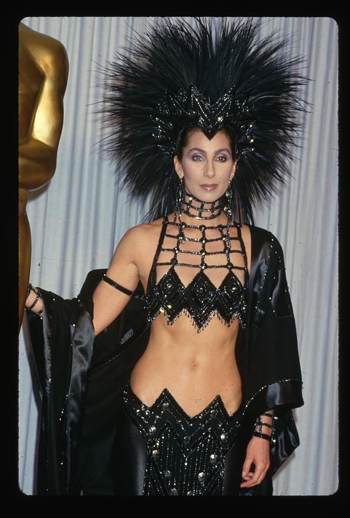 Cher wears an elaborate, yet very revealing outfit to the Academy Awards.   (Photo by LGI Stock/Corbis/VCG via Getty Images)