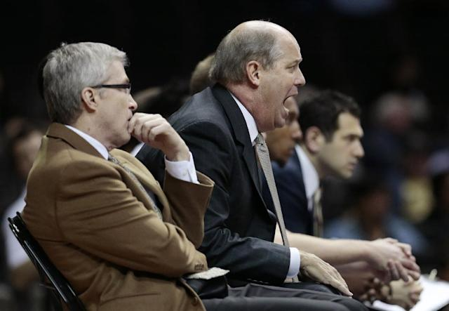 Vanderbilt coach Kevin Stallings, center, yells to his players in the first half of an NCAA college basketball game against Georgia State on Tuesday, Nov. 12, 2013, in Nashville, Tenn. (AP Photo/Mark Humphrey)