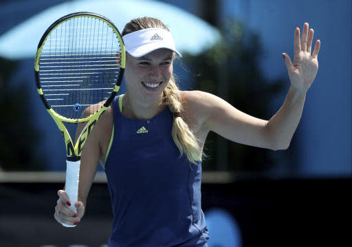 Denmark's Caroline Wozniacki reacts during a practice session ahead of the Australian Open tennis championships in Melbourne, Australia, Saturday, Jan. 12, 2019. (AP Photo/Mark Schiefelbein)