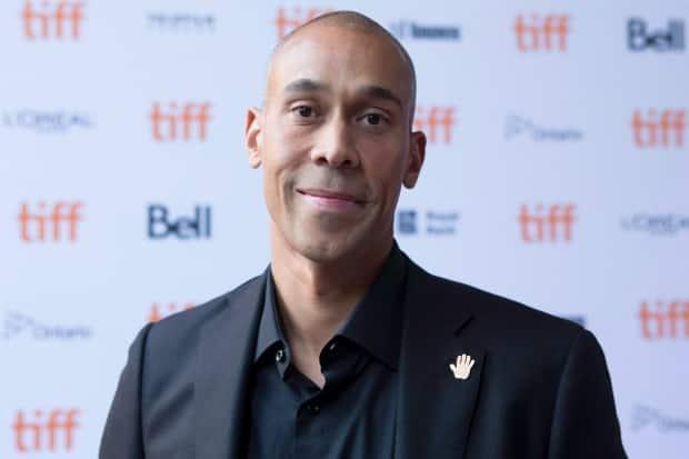 Hubert Davis on the red carpet for the film Giants of Africa during the 2016 Toronto International Film Festival, Sept. 16, 2016. His new documentary, Black Ice, will begin filming this fall. (Chris Young/The Canadian Press - image credit)