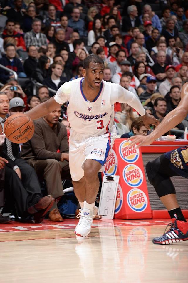 LOS ANGELES, CA - MARCH 1: Chris Paul #3 of the Los Angeles Clippers drives to the basket during a game against the New Orleans Pelicans at STAPLES Center on March 1, 2014 in Los Angeles, California. (Photo by Andrew D. Bernstein/NBAE via Getty Images)