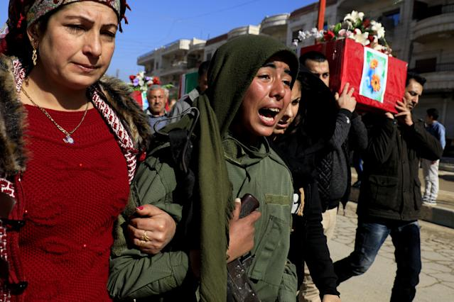 <p>Syrian Kurds mourn during a funeral in the town of Afrin on Jan. 29, 2018, of civilians and fighters from the Syrian Kurdish People's Protection Units (YPG) who were killed in battles in Syria's border region of Afrin as the Turkish army press an offensive against Kurdish militia in the area. (Photo: Delil Souleiman/AFP/Getty Images) </p>