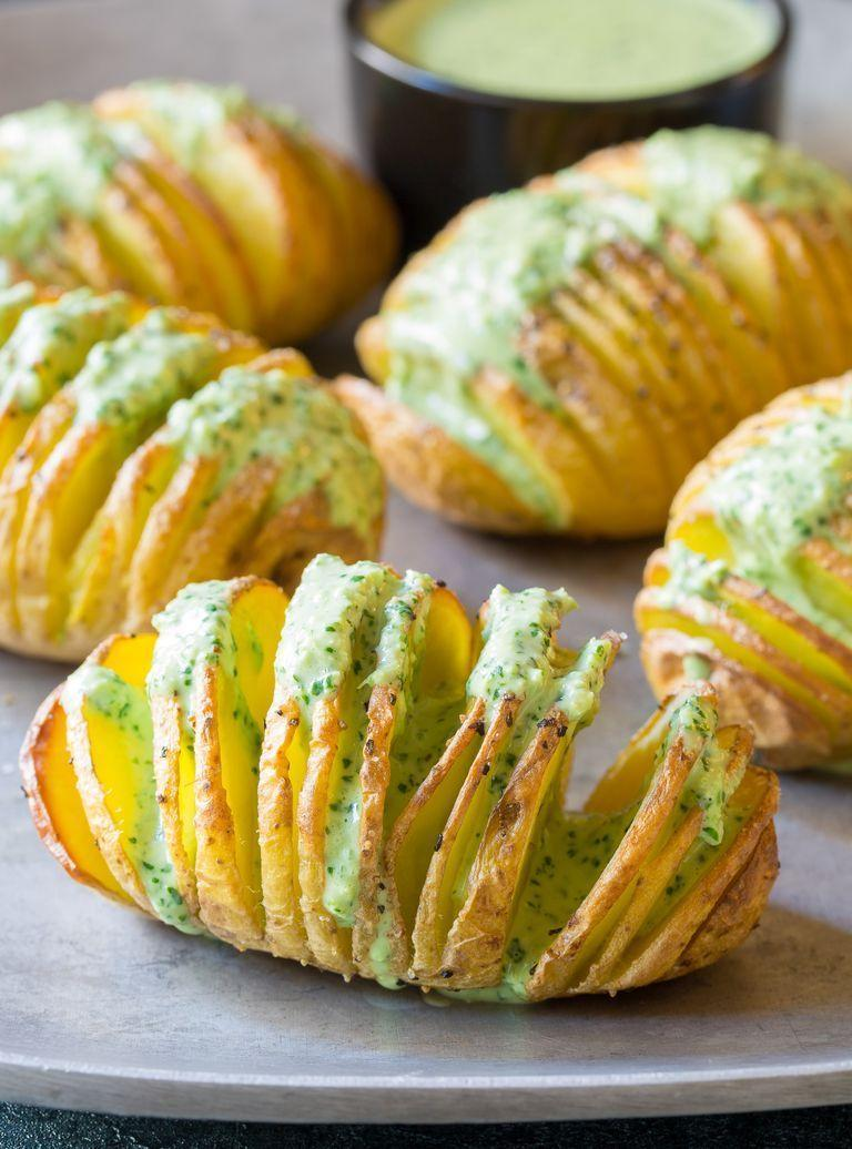 "<p>Surprise your dinner guests and make these crispy Hasselback potatoes instead of mashed potatoes. It's a creative dish that's full of flavor.</p><p><strong><a href=""https://www.thepioneerwoman.com/food-cooking/recipes/a96774/crispy-hasselback-potatoes-for-your-steak-dinner/"" rel=""nofollow noopener"" target=""_blank"" data-ylk=""slk:Get the recipe."" class=""link rapid-noclick-resp"">Get the recipe.</a></strong></p><p><strong><a class=""link rapid-noclick-resp"" href=""https://go.redirectingat.com?id=74968X1596630&url=https%3A%2F%2Fwww.walmart.com%2Fbrowse%2Fhome%2Fthe-pioneer-woman-dishes%2F4044_623679_639999_7373615&sref=https%3A%2F%2Fwww.thepioneerwoman.com%2Ffood-cooking%2Fmeals-menus%2Fg33251890%2Fbest-thanksgiving-sides%2F"" rel=""nofollow noopener"" target=""_blank"" data-ylk=""slk:SHOP DINNERWARE"">SHOP DINNERWARE</a></strong></p>"