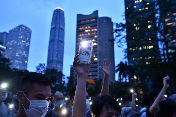 Pro-democracy protesters march in the Central district of Hong Kong as the city marks the one-year anniversary since pro-democracy protests erupted following opposition to a bill allowing extraditions to mainland China. (AFP Photo/Anthony WALLACE)