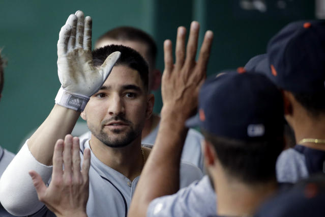Detroit Tigers' Nicholas Castellanos celebrates in the dugout after hitting a solo home run during the first inning of a baseball game against the Kansas City Royals Tuesday, June 11, 2019, in Kansas City, Mo. (AP Photo/Charlie Riedel)