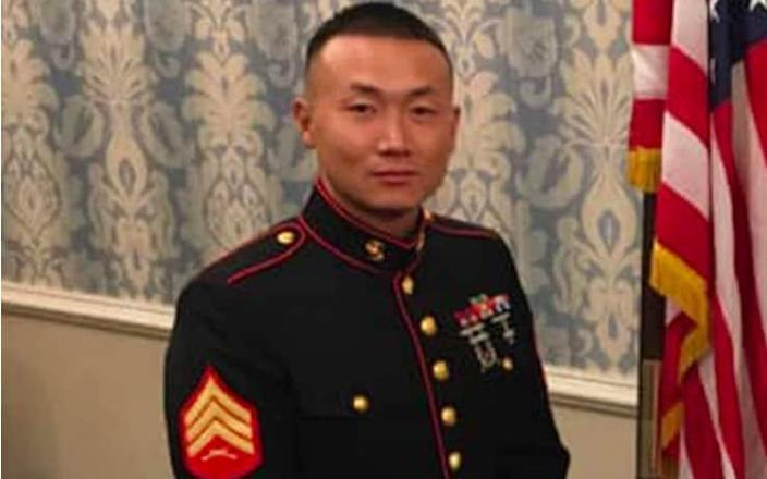Baimadajie Angwang, a community affairs liaison at the 111th Precinct in Queens and a member of the US Marine Corps Reserve, - NYC Police Benevolent Association / Facebook