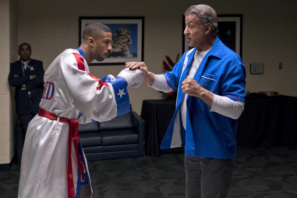 "FILE – This image released by Metro Goldwyn Mayer Pictures / Warner Bros. Pictures shows Michael B. Jordan, left, and Sylvester Stallone in a scene from ""Creed II."" (Barry Wetcher/Metro Goldwyn Mayer Pictures/Warner Bros. Pictures via AP, File)"