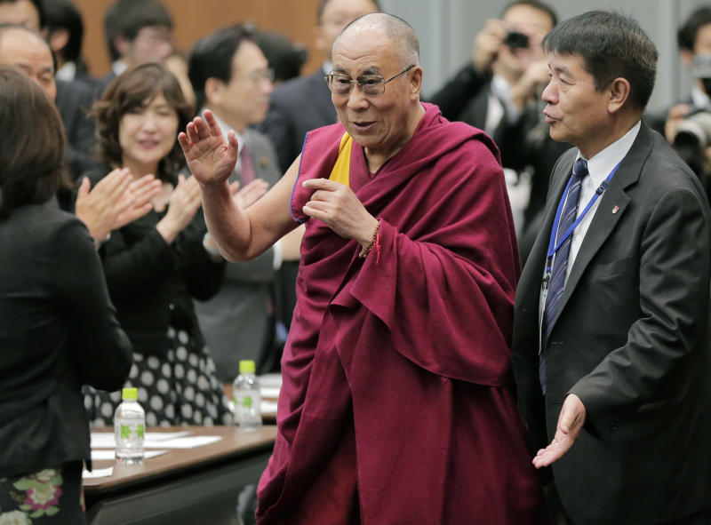 Tibetan spiritual leader the Dalai Lama arrives at a seminar held by Japanese Diet members in Tokyo, Tuesday, Nov. 13, 2012.  (AP Photo/Itsuo Inouye)