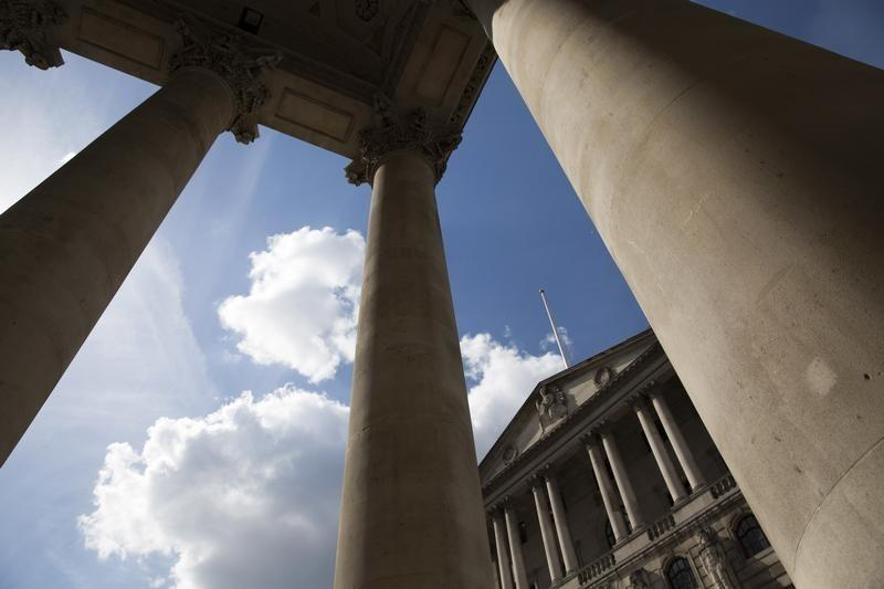 The Bank of England is seen through columns in the City of London