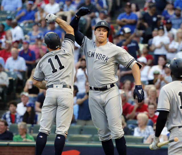 New York Yankees Brett Gardner (11) celebrates with Aaron Judge (99) after Judge hit a two-run home run against the Texas Rangers during the fifth inning of a baseball game Wednesday, May 23, 2018, in Arlington, Texas. (AP Photo/Michael Ainsworth)