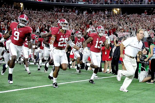 Nick Saban and Alabama have mastered the scheduling game, which last year included a visit to Texas to play USC. (Getty)