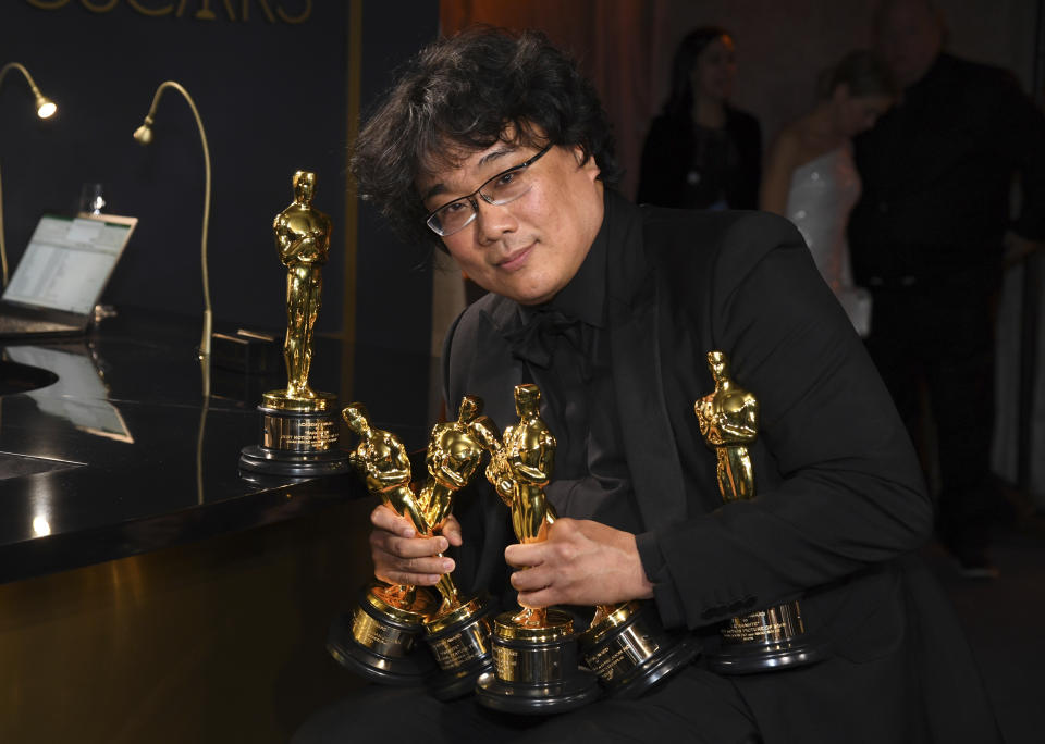 """Bong Joon-ho holds the Oscars for best original screenplay, best international feature film, best directing, and best picture for """"Parasite"""" at the Governors Ball after the Oscars on Sunday, Feb. 9, 2020, at the Dolby Theatre in Los Angeles. (Photo by Richard Shotwell/Invision/AP)"""