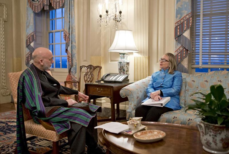 Secretary of State Hillary Rodham Clinton meets with Afghanistan President Hamid Karzai, left, at the State Department in Washington, Thursday, Jan. 10, 2013. (AP Photo/J. Scott Applewhite)