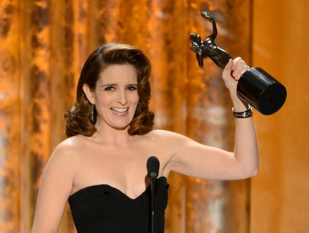 Tina Fey accepts the award for Outstanding Performance by a Female Actor in a Comedy Series for '30 Rock' onstage during the 19th Annual Screen Actors Guild Awards held at The Shrine Auditorium on January 27, 2013 --