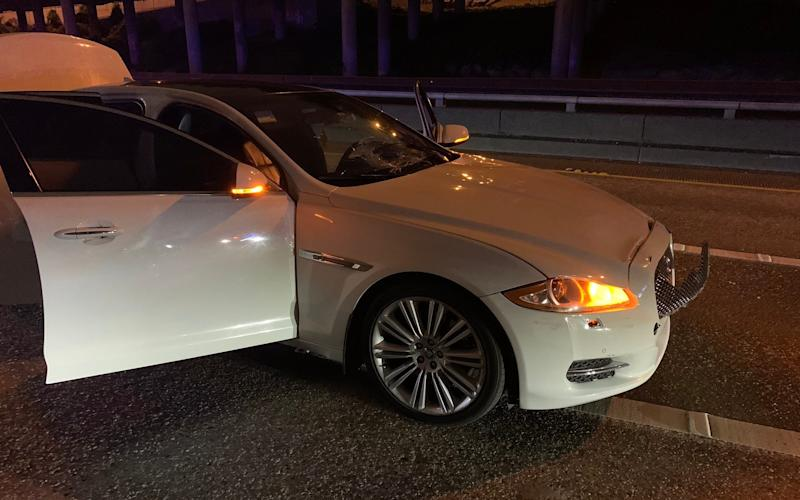 The white Jaguar suspected of striking protesters in Seattle. Police arrested a 27-year-old man at the scene. - Twitter