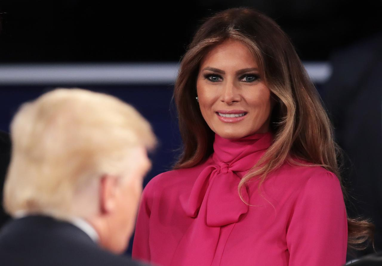 <p>Melania wore a $1,500 Gucci fuchsia pussy-bow blouse at the second of three presidential debates in October 2016, shortly after her husband's <em>Access Hollywood</em> tape scandal. (Photo: Getty Images) </p>