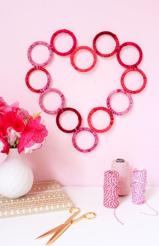 """<p>Here's a fun — and super thrifty — way to fill up blank wall space. Plus, it's appropriate enough to leave up year-round. </p><p><em><a href=""""https://designimprovised.com/2018/01/diy-yarn-wrapped-heart-wreath.html"""" rel=""""nofollow noopener"""" target=""""_blank"""" data-ylk=""""slk:Get the tutorial at Design Improvised »"""" class=""""link rapid-noclick-resp"""">Get the tutorial at Design Improvised »</a></em></p>"""