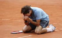 FILE - Switzerland's Roger Federer reacts after defeating Sweden's Robin Soderling during their men's singles final match of the French Open tennis tournament at Roland Garros stadium in Paris, in this Sunday June 7, 2009, file photo. Federer is about to compete in the last French Open of his 30s and says he knows he cannot win the title. The tournament begins Sunday, May 30, 2021, in Paris. (AP Photo/Bernat Armangue, File)